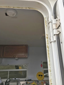 Weatherstripping removed from right side of door