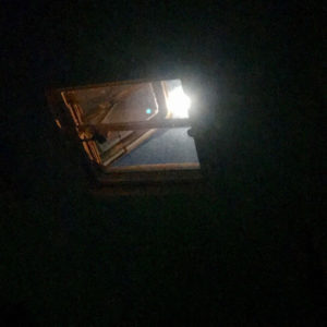 A full moon shines down through my vent at night